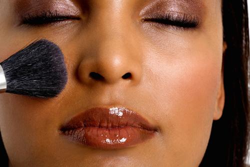 Black woman putting on makeup-7923